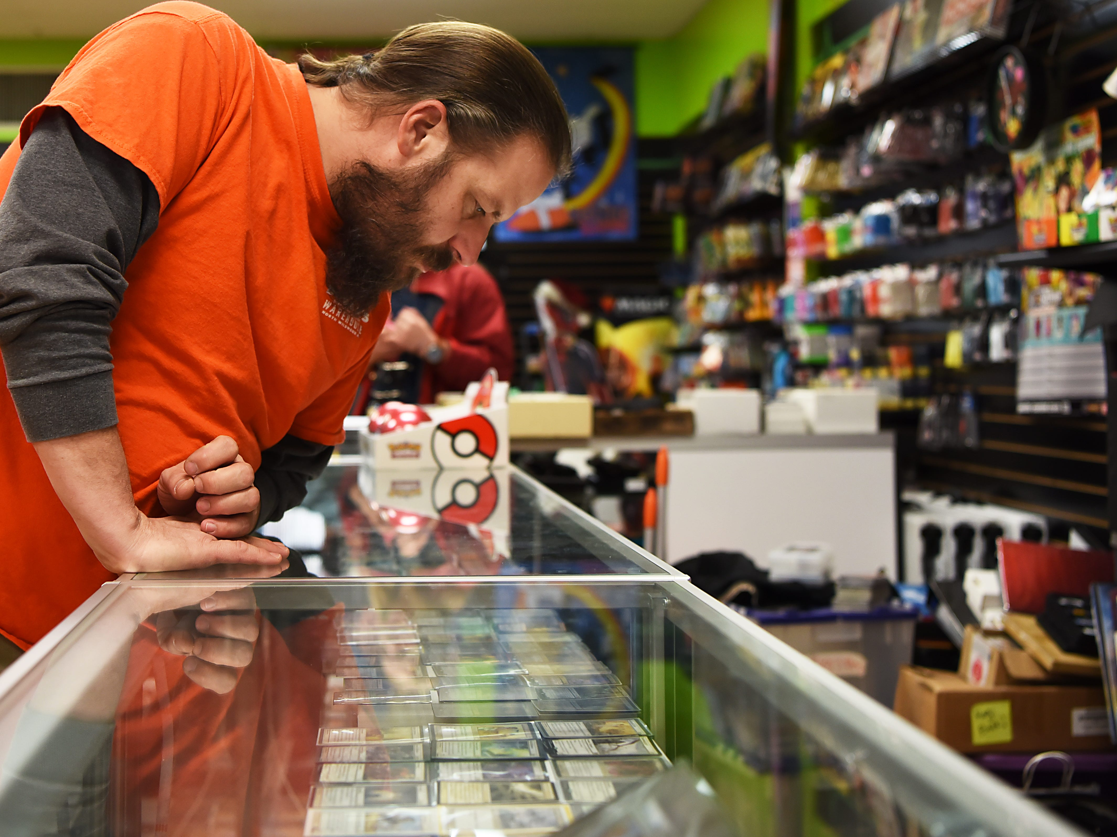 Ian Dampman from Pompton Lakes looks at Magic: The Gathering cards at Level 1 Games in Pompton Plains on Friday November 30, 2018.