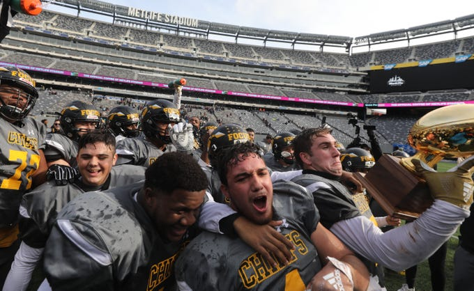 The Piscataway Chiefs celebrate their championship win over Ridgewood.