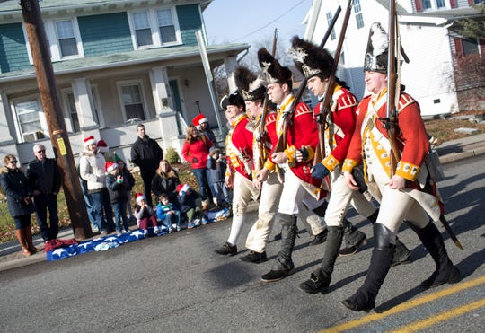 The Royal Sussex Society, including (from left) John Van Vliet, Tom Carton, Stephen Pellegrini, Alexander Pena and Kimberly Griffin march down Lafayette Avenue during the 33rd Annual Santa Parade in Hawthorne on Saturday, Dec. 1, 2018.