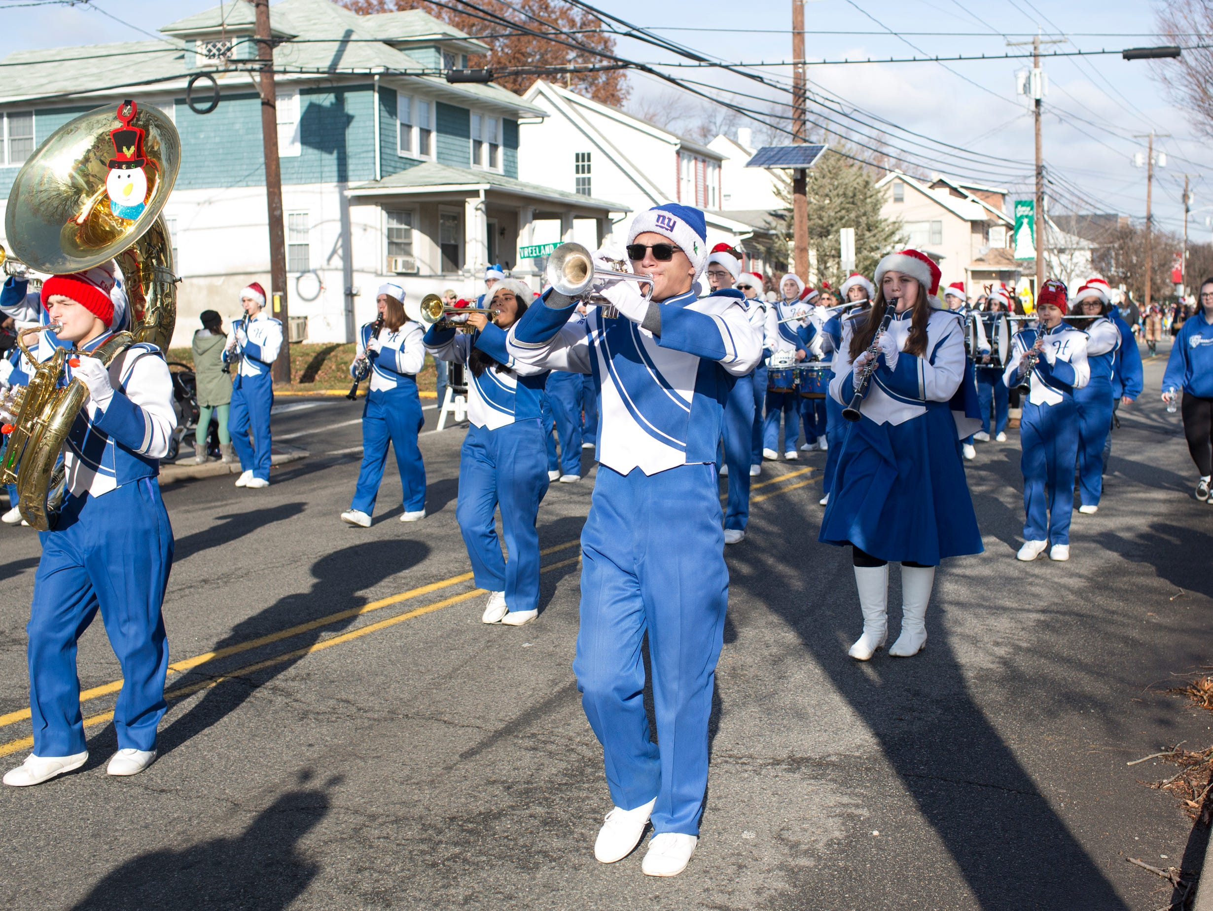 T.J. Marks (left) and Michael Rica (center) play together with the Hawthorne High School Marching Band on Lafayette Avenue during the 33rd Annual Santa Parade in Hawthorne on Saturday, Dec. 1, 2018.