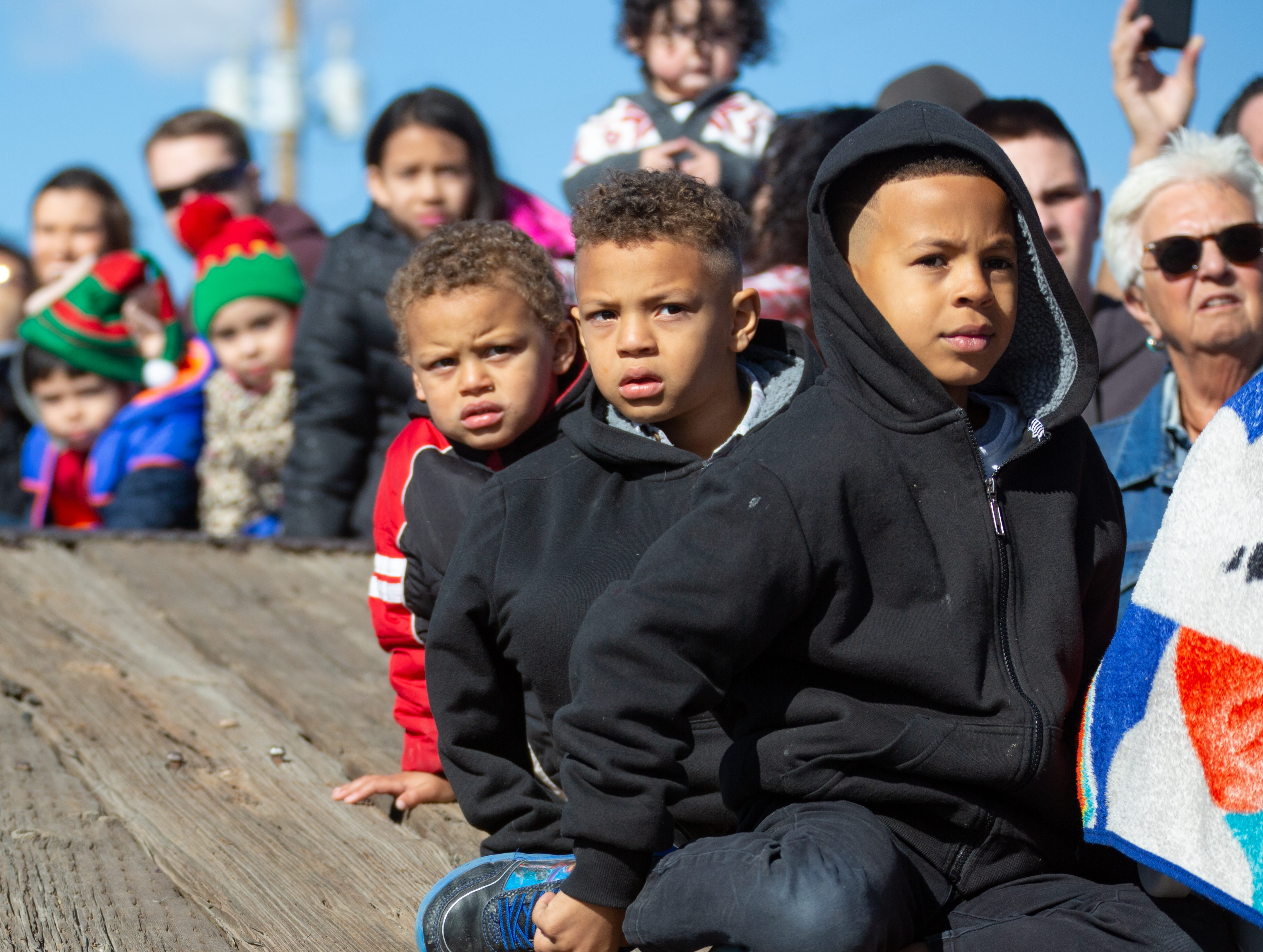 Deandre Harris, 7, right, and is brothers Makhai, 6, center, and Jamayes,3, left, watch for Santa to arrive by train on Saturday, Dec. 1, 2018 during the Railroad Museum Holiday Open House. During the event children were able to visit with Santa and particiapate in Christmas craft making.
