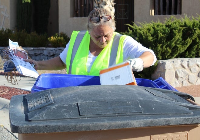 Cecelia Martinez, recycling auditor, examines materials diverted into the blue bin for recycling.