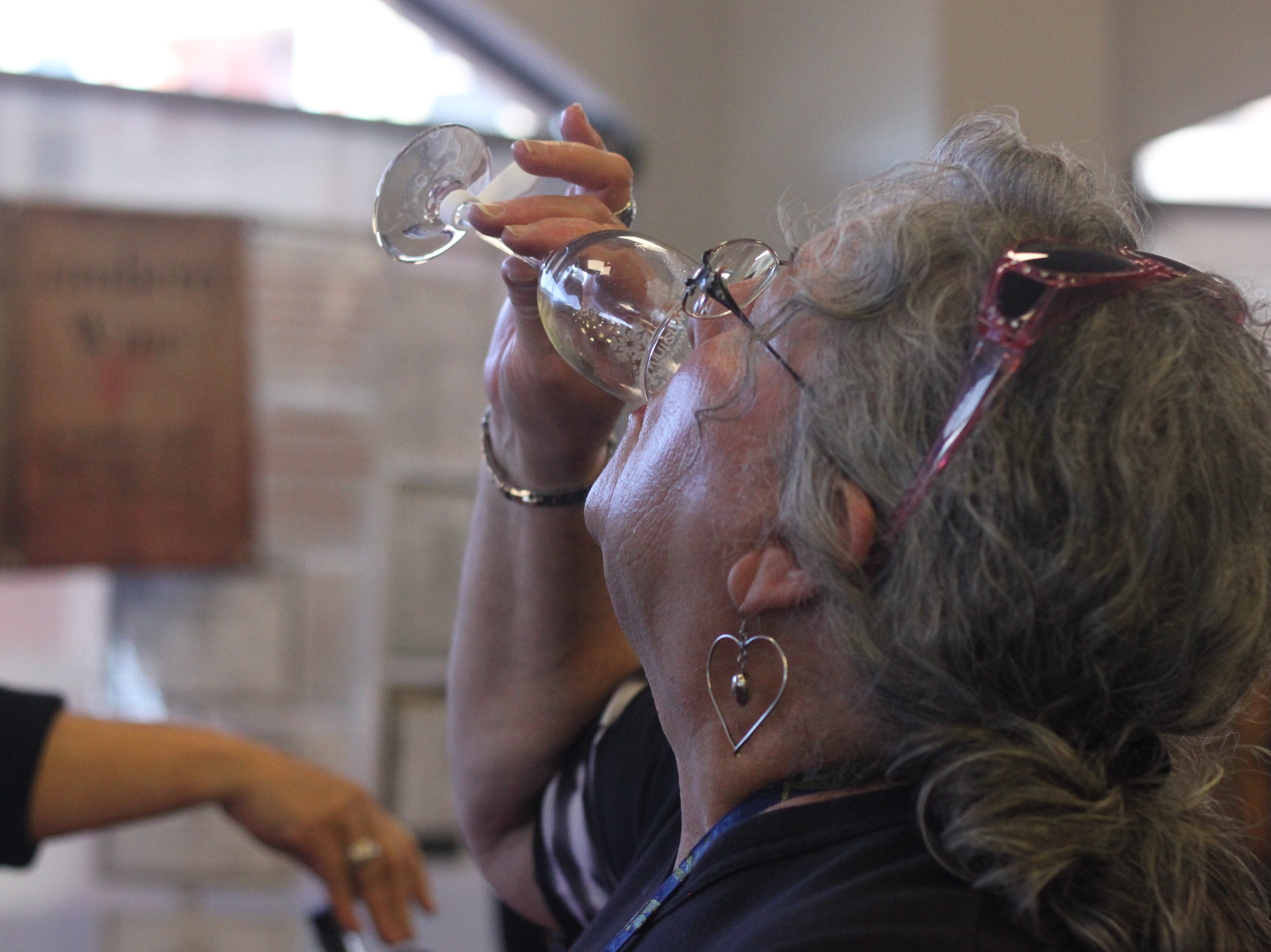 Attendees sample New Mexico wines and browse various craft vendors at Carlsbad's annual Winter Wine Festival, Dec. 1, 2018 at the Pecos River Village Conference Center.