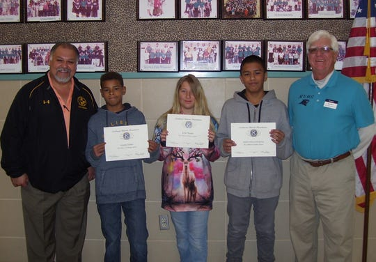 Mountain View Middle School pictured left to right: Mountain View Principal Moises Cardiel, and students Artontis Outlaw, Kylie Thomas, Isaiah Telles-Concepcion, and Kiwanis Club member Ned Kline.