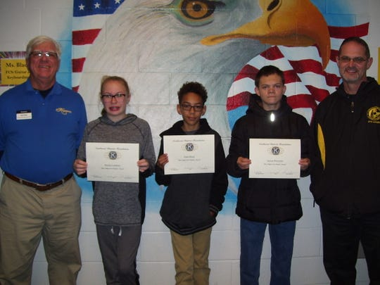 Holloman Middle School pictured left to right: Kiwanis Club member Ned Kline, Holloman students Baylee Lundeen, Gabe Black, Jayson Perryman, and Holloman Principal Steven Starkovitch.