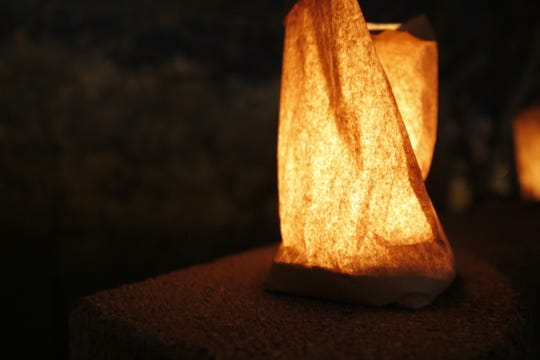 A luminaria is pictured Friday during Riverglo in Berg Park in Farmington.
