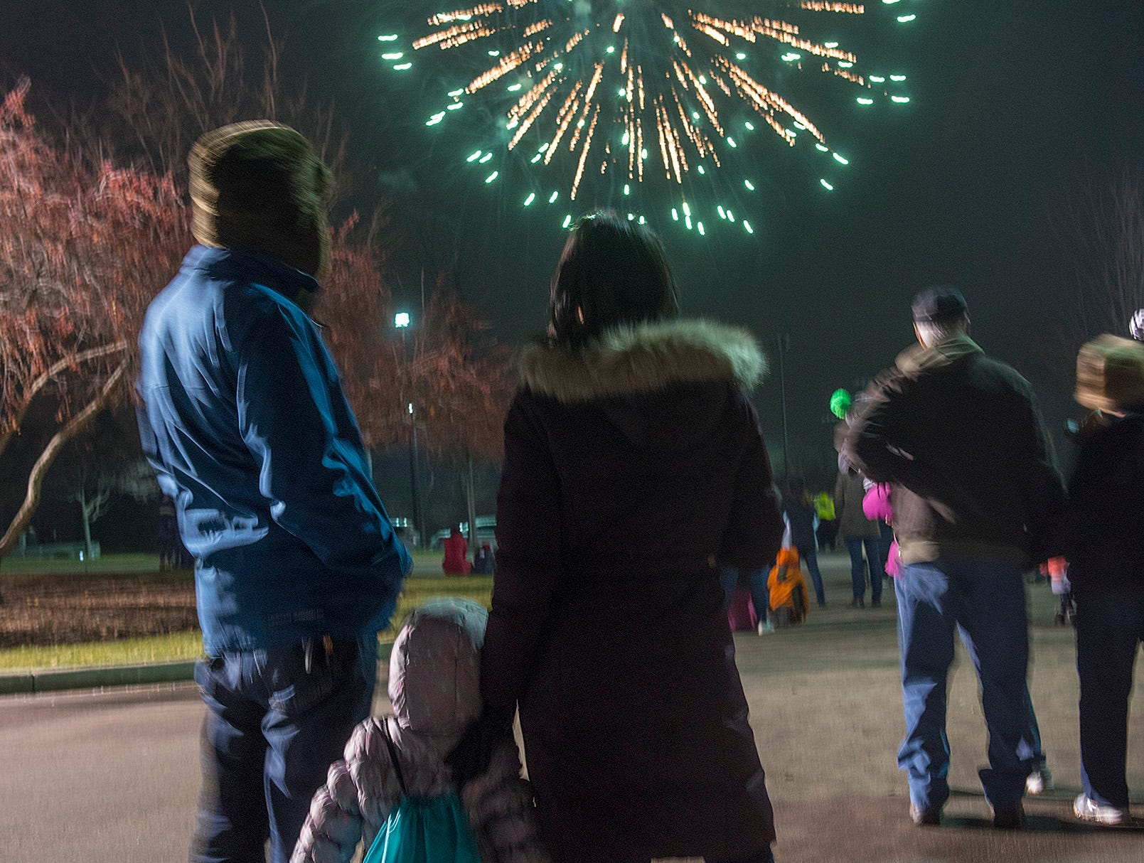 Nandish Doshi, Ranjana Doshi, and two year old daughter Jasmine watch the fireworks show.