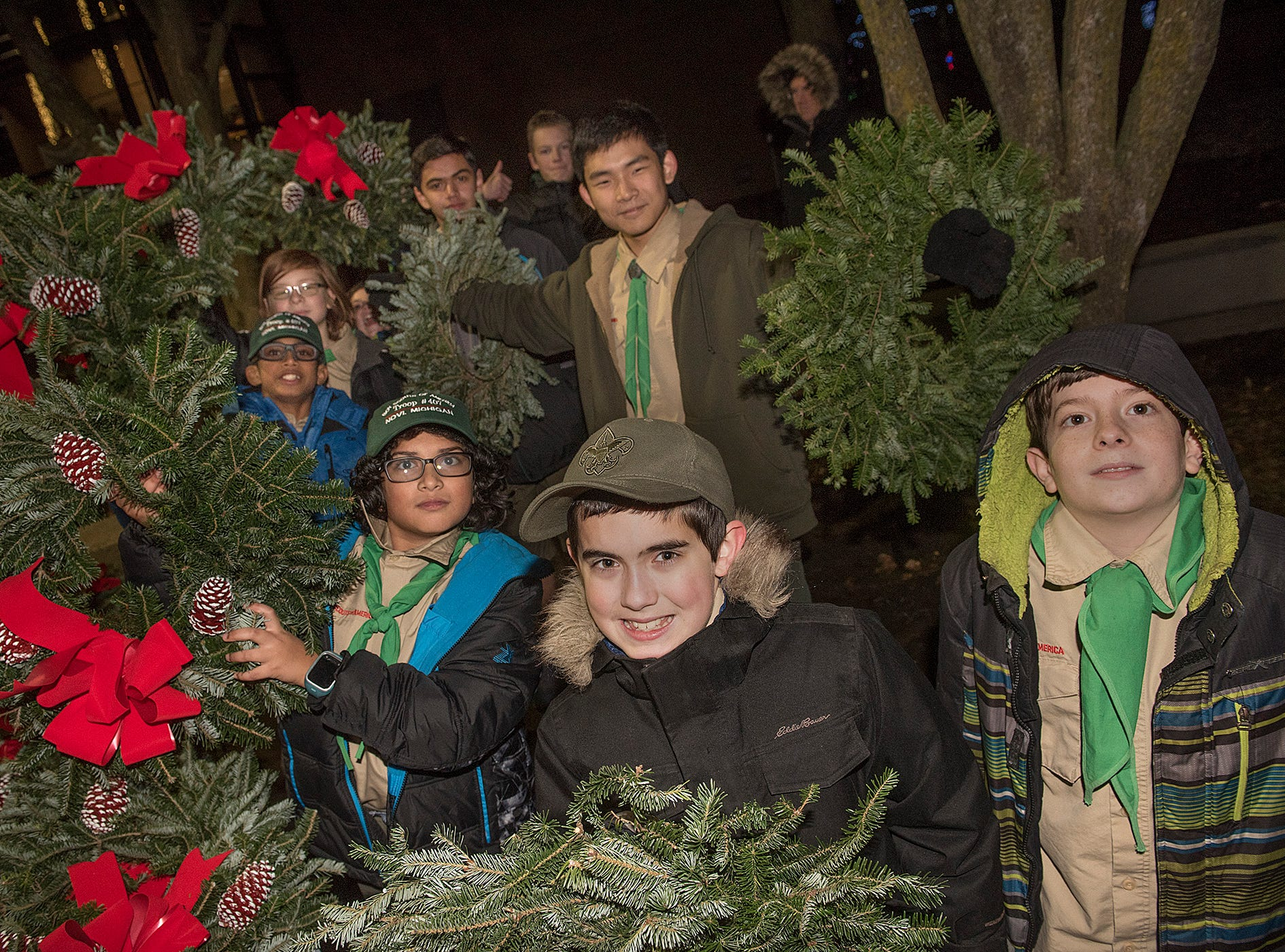 The guys from Novi Boy Scout Troop 407 are selling wreaths and poinsettias.