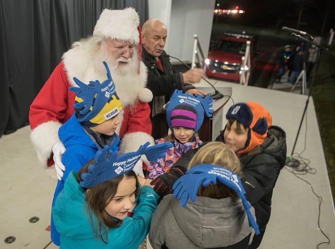 Santa Claus, Mayor Bob Gatt and friends light the tree and the fireworks begin.