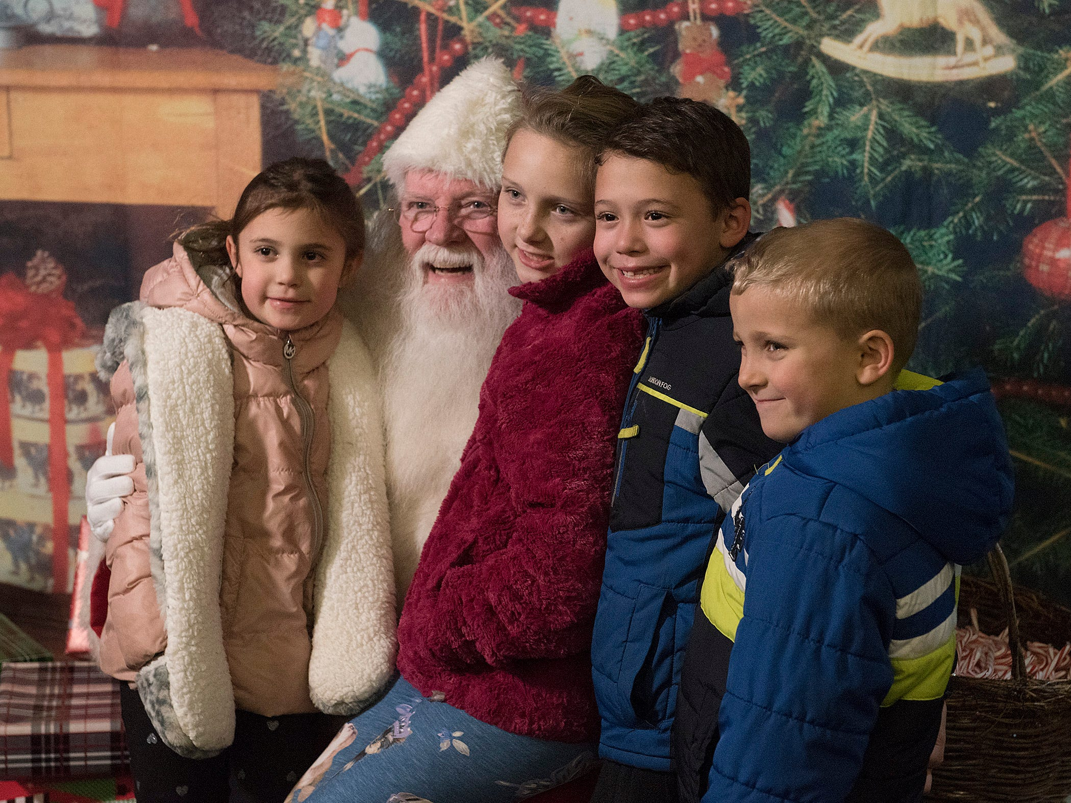 Aubriana Schwartz, 5 years old, Emma Crane, 8, Dominic Schwartz, 7, and Carson Crane, 5, meet the one and only Santa Claus.