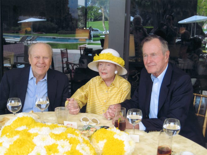Former presidents Gerald Ford and George H.W. Bush sit to the left and right of Leonore Annenberg in this undated photo.