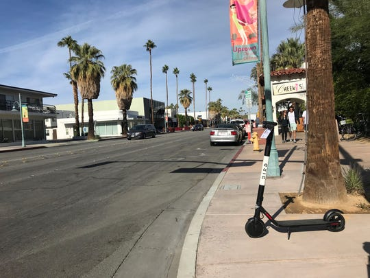 A Bird Scooter is seen on Palm Canyon Drive in downtown Palm Springs. That city has shut down the operation, for now.