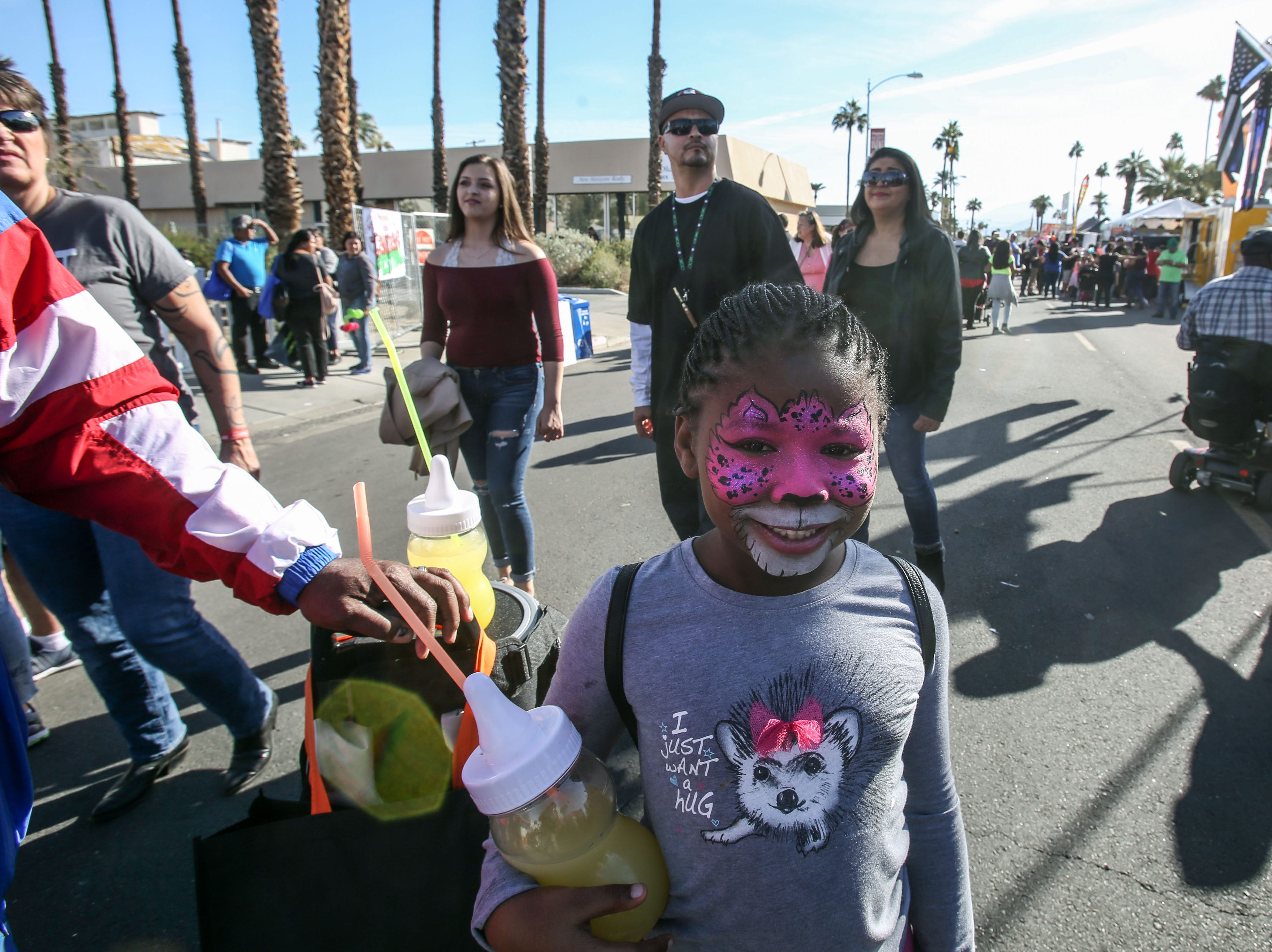 Samiya Lamb, 6, got her face painted on Saturday, December 1, 2018 during annual Indio Tamales Festival.