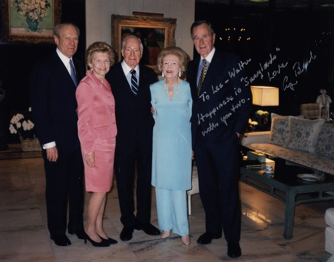 """In April 1999, former President Gerald Ford (from left), Betty Ford, Walter Annenberg, Leonore Annenberg and President George H.W. Bush pose at Sunnylands. The inscription reads, """"To Lee – Walter Happiness is 'Sunnylands' with you two - George Bush"""