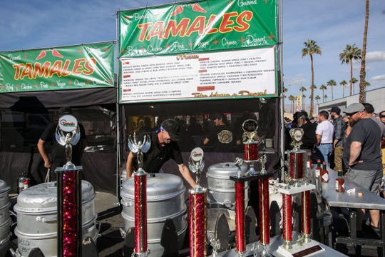 Steamers and trophies at Barrett's Gourmet Tamales stand  on Saturday, December 1, 2018 during annual Indio Tamales Festival.