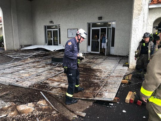 The porte-cochère ceiling of the Hadji Shrine Temple on West Nine Mile Road collapsed Saturday morning, hospitalizing one adult woman.