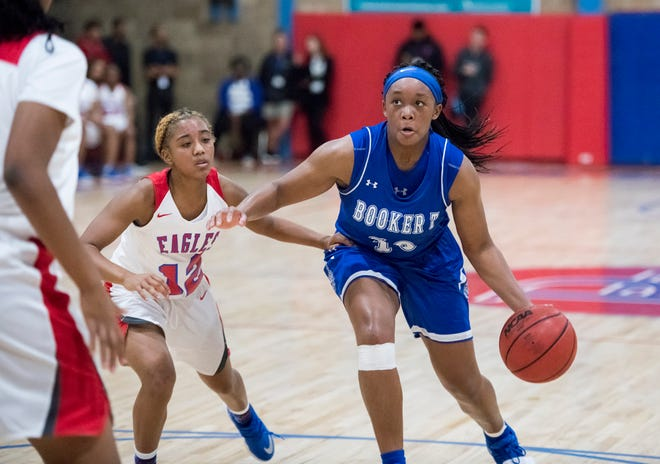 Janelle Jones (10) eyes the hoop during the Booker T. Washington vs Pine Forest girls basketball game at Pine Forest High School on Friday, November 30, 2018.