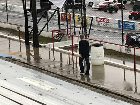 Tim Bryant, general manager and co-owner of Five Flags Speedway, had walks toward track entrance Saturday after severe weather wiped out the entire race schedule for the day. Sunday's Snowball Derby is still scheduled as planned.