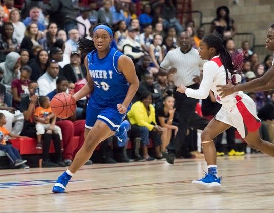 Janelle Jones (10) dribbles during the Booker T. Washington vs Pine Forest girls basketball game at Pine Forest High School on Friday, November 30, 2018.