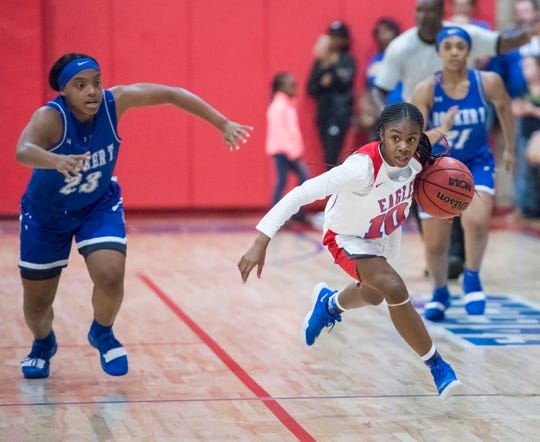 Tahnyjia Purifoy (10) brings the ball up court during the Booker T. Washington vs Pine Forest girls basketball game at Pine Forest High School on Friday, November 30, 2018.