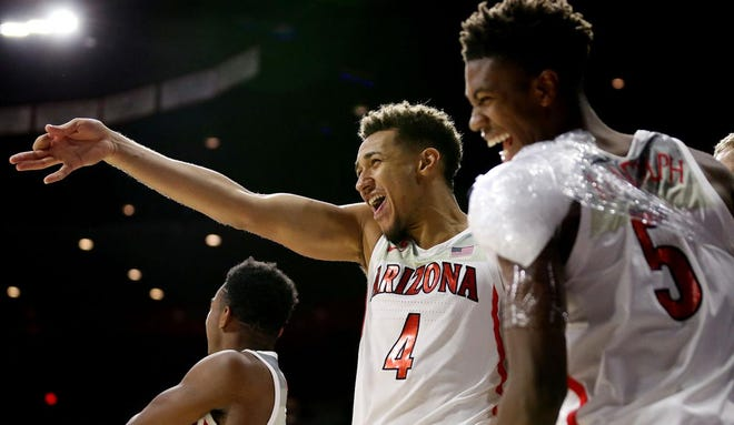 Arizona Wildcats center Chase Jeter (4) and guard Brandon Randolph (5) celebrate from the bench after Alex Barcello (23) buried a 3-pointer.