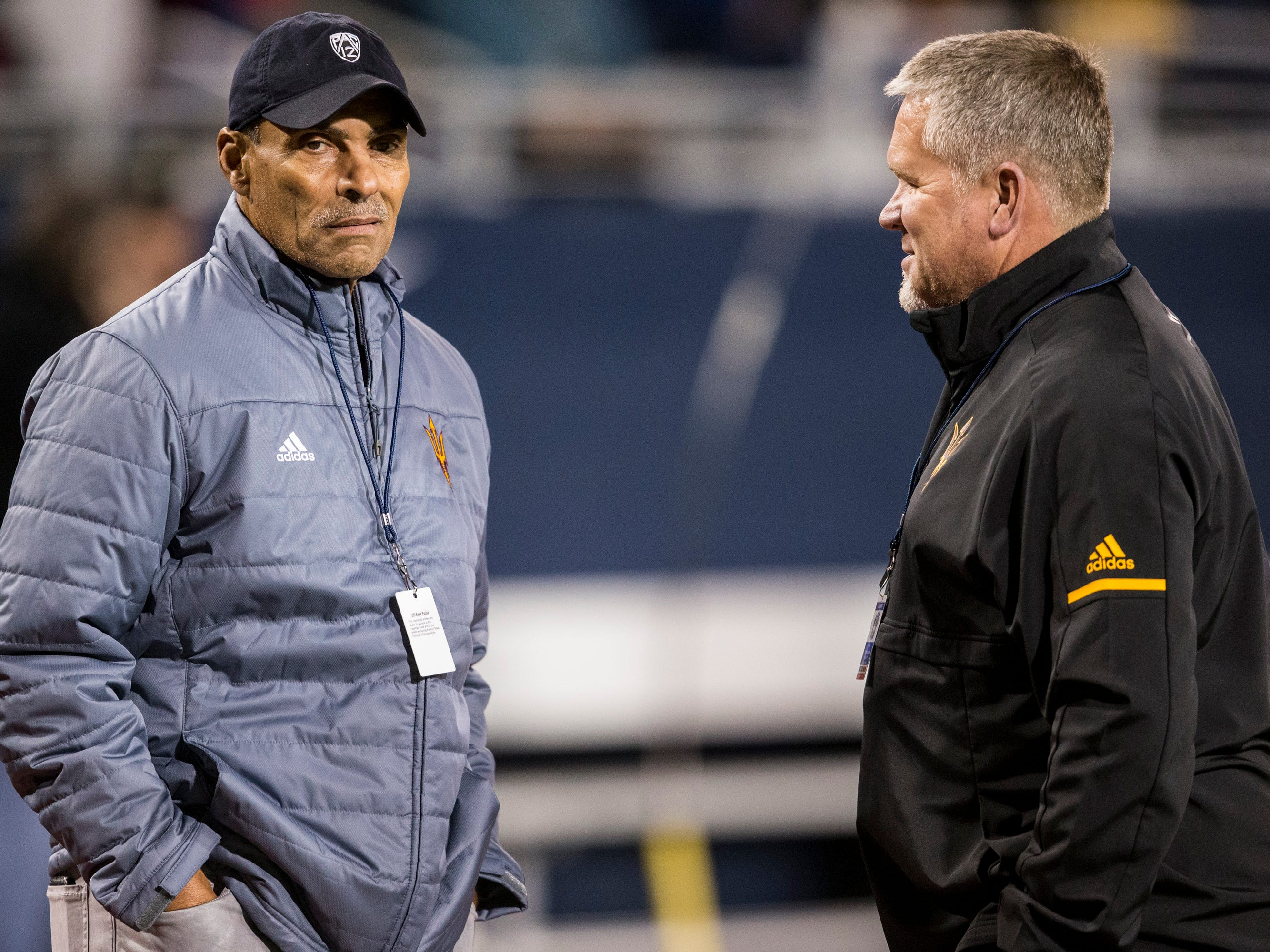 ASU's Herm Edwards and Shawn Slocum talk before the 4A State Championship between Salpointe and Saguaro on Friday, Nov. 30, 2018, at Arizona Stadium in Tucson, Ariz. 
