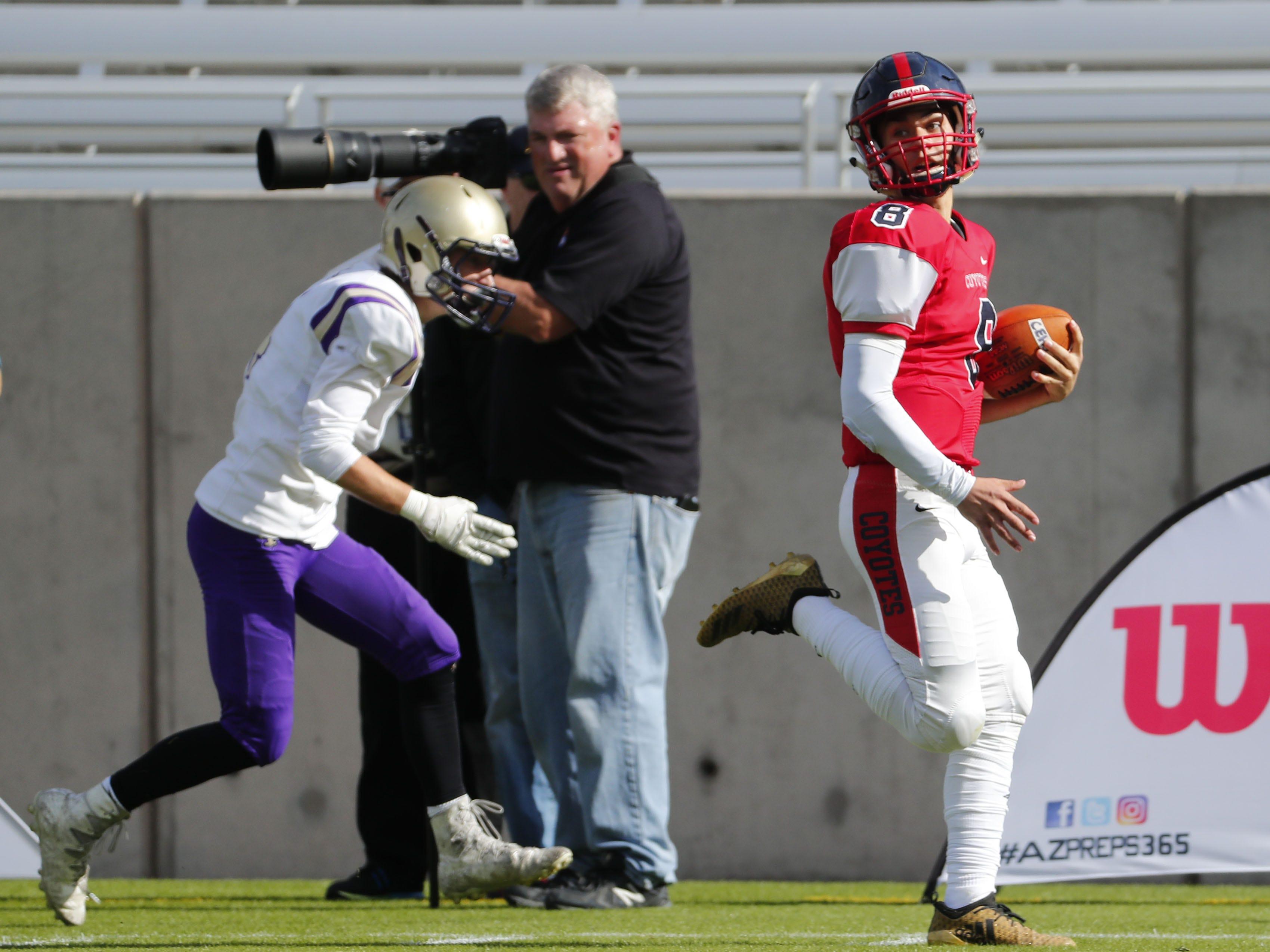 Centennial quarterback Jonathan Morris (8) looks back during a touchdown run against Notre Dame Prep cornerback Adam Boyer (4) during the 5A state football championship at Sun Devil Stadium December 1, 2018. #azhsfb