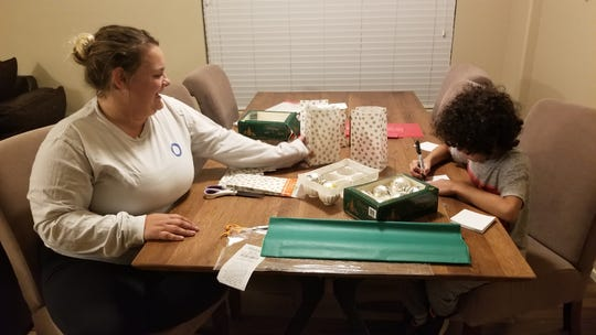 Ceene Brazlovitz and her 7-year-old son Bentley have made 300 ornaments to raise money to restock the toy closet at Cardon Children's Medical Center.