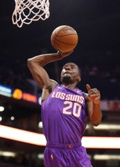 Suns' Josh Jackson (20) dunks against the Magic during the first half at Talking Stick Resort Arena in Phoenix, Ariz. on November 30, 2018.