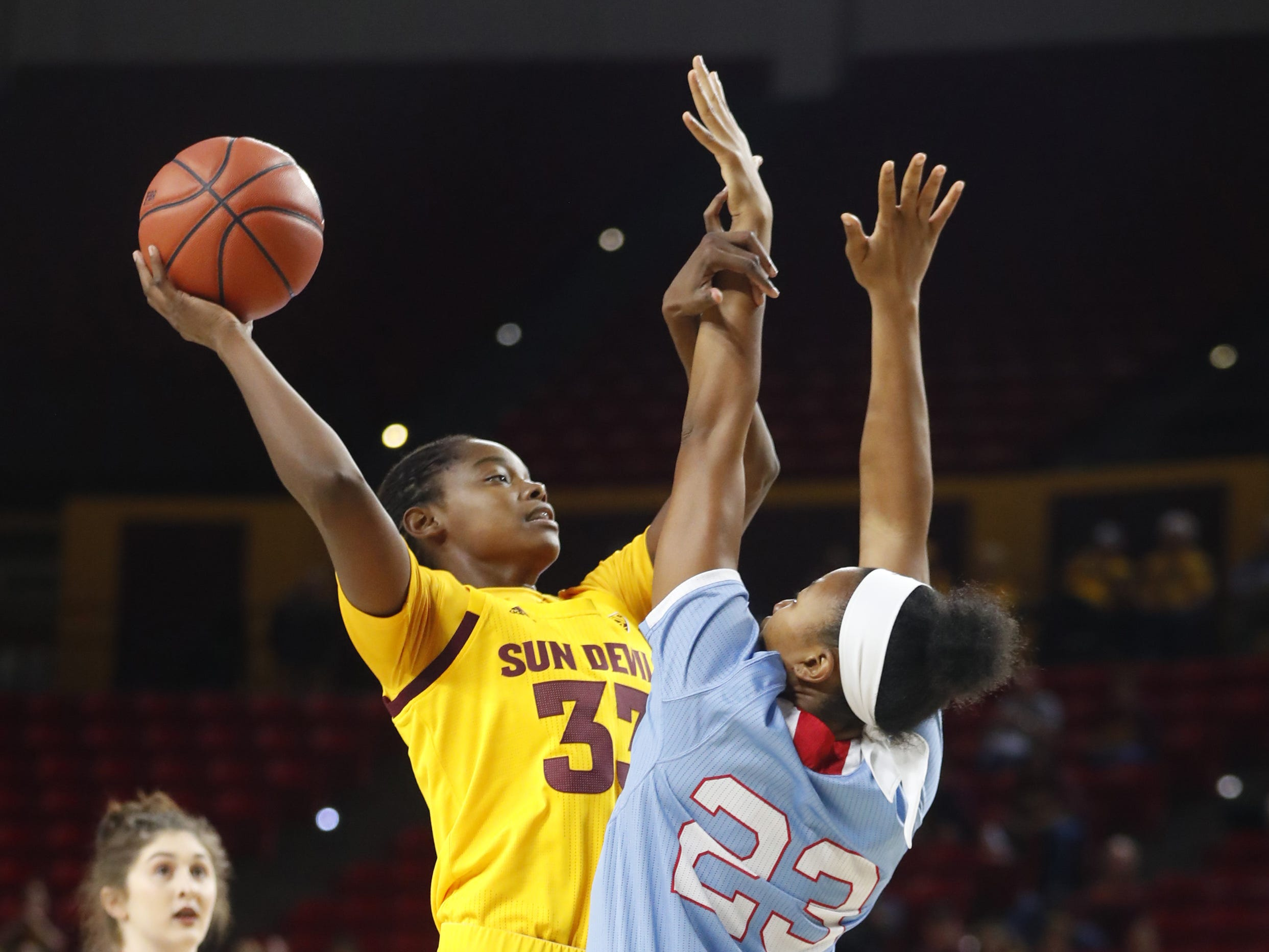 ASU's Charnea Johnson-Chapman (33) shoots against Louisiana Tech's Reauna Cleaver (23) during the first half at Wells Fargo Arena in Tempe, Ariz. on November 30, 2018.