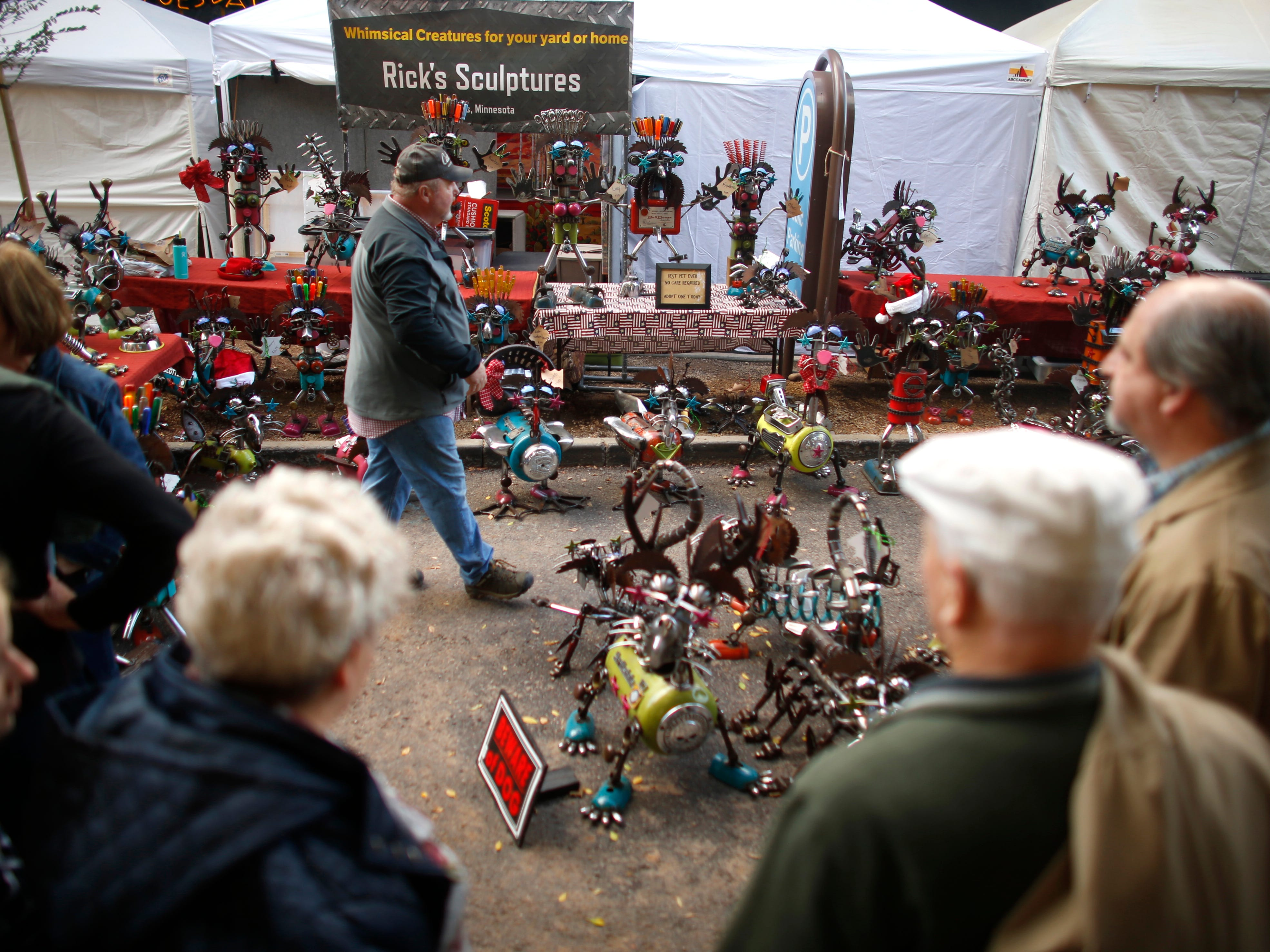 "Rick Murphy's sculptures made from ""junk"" for sale at the Tempe Festival of the Arts on Mill Avenue on Friday, November 30, 2018."