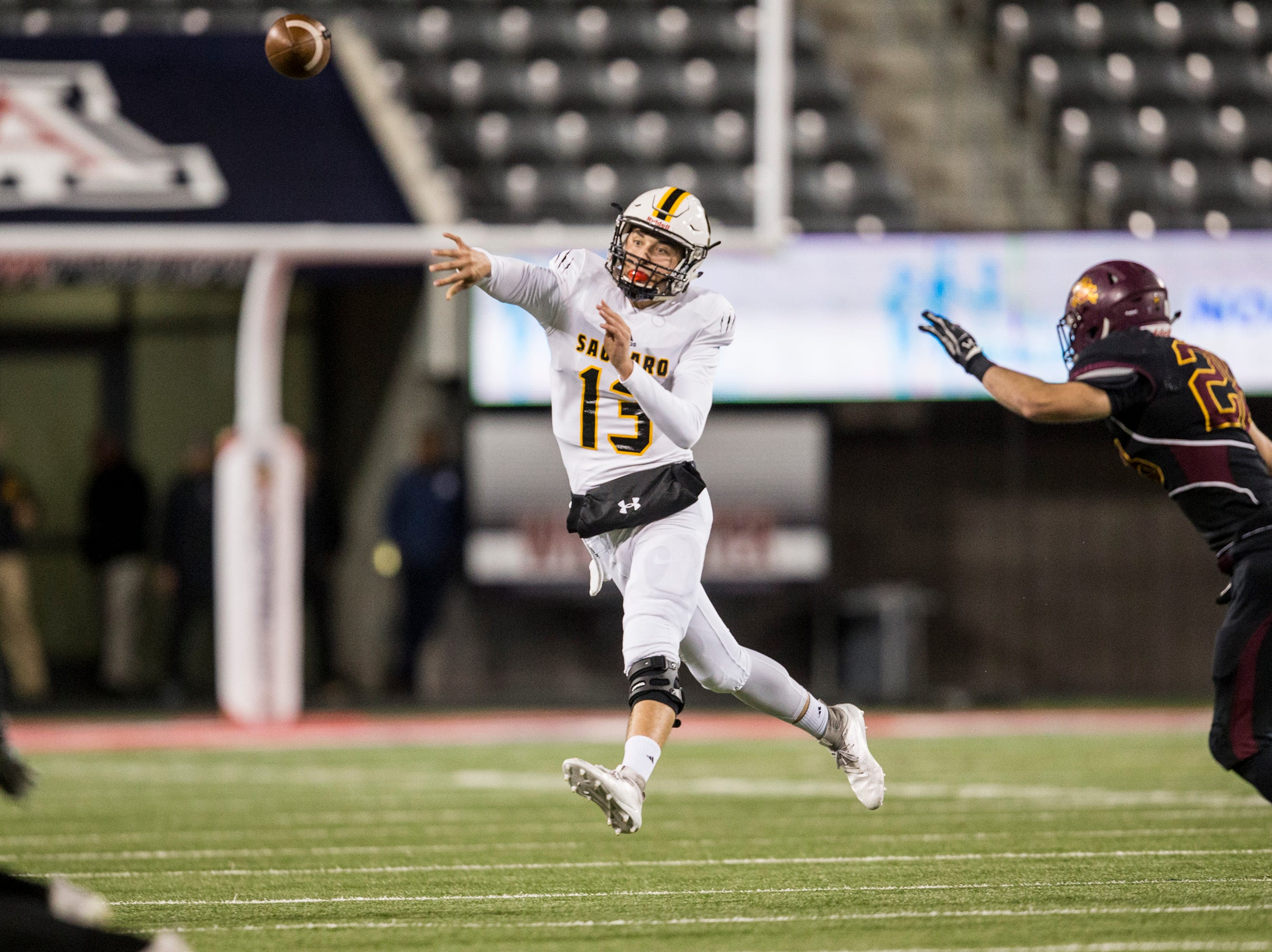 Saguaro's Tyler Beverett throws against Salpointe during the first half of the 4A State Championship on Friday, Nov. 30, 2018, at Arizona Stadium in Tucson, Ariz. 