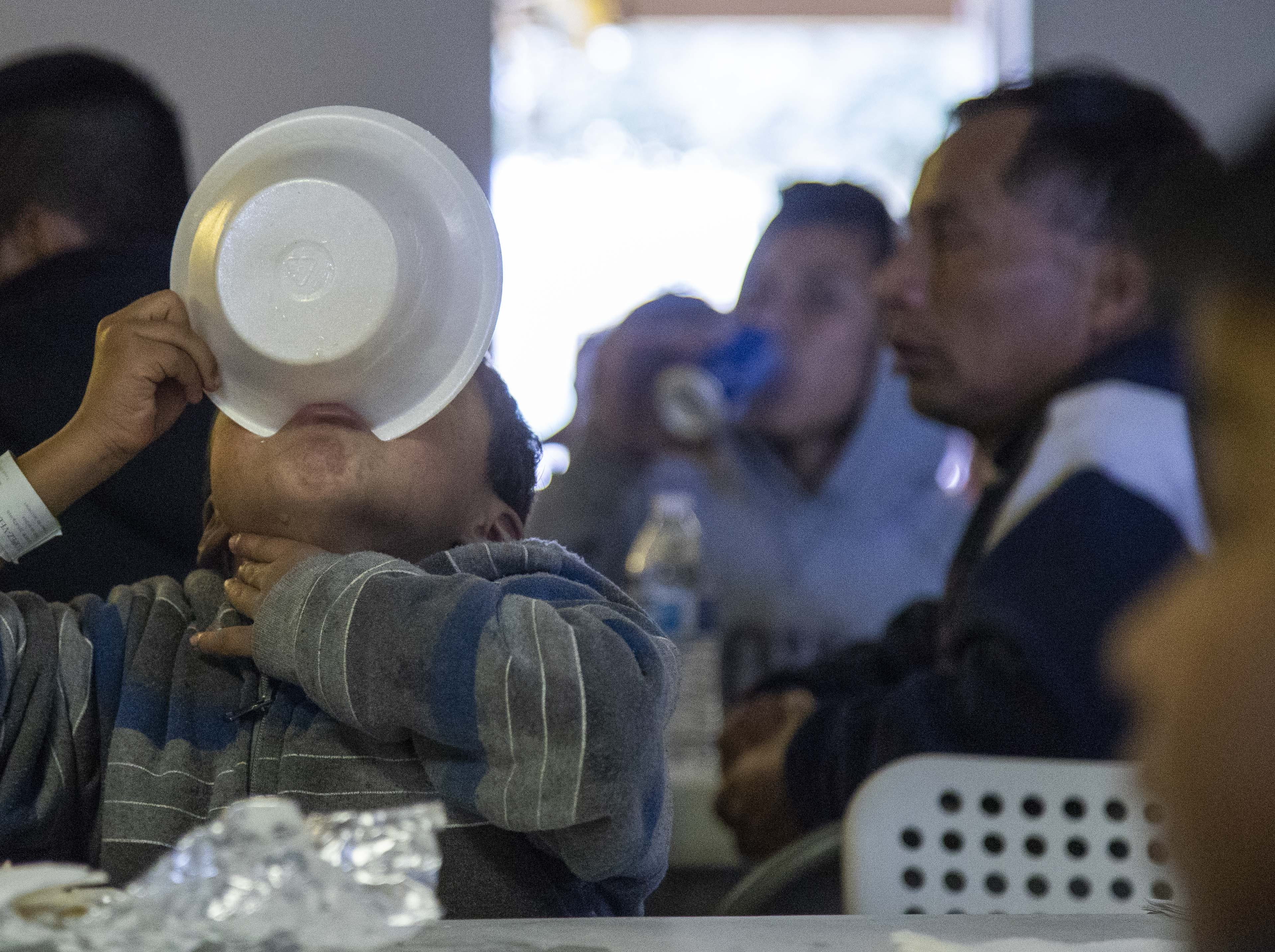 A child eats at Casa de Oracion Number 2 in north Phoenix.