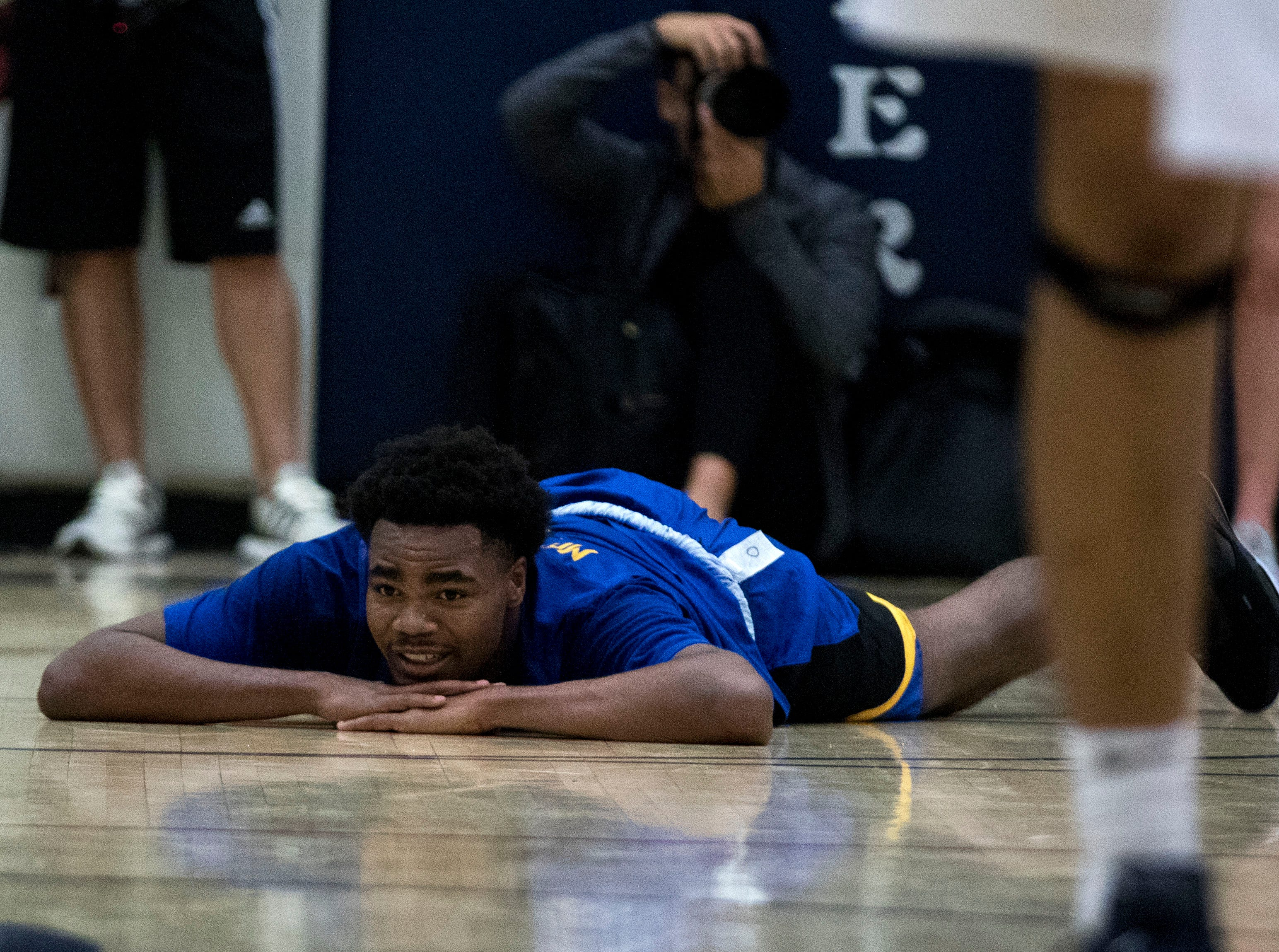 Shadow Mountain's Jalen Williams lays on the floor in disbelief after getting called for a foul during the second half of their game with Pinnacle in Phoenix, Friday, Nov. 30, 2018.