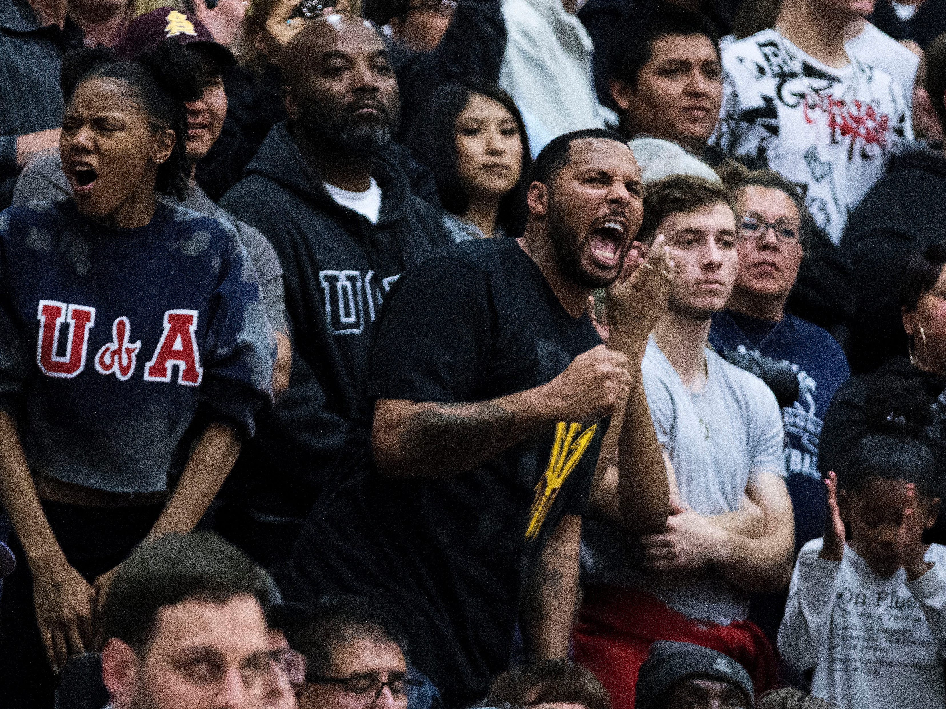 Shadow Mountain dad and former NBA player Eddie House cheers on his son and his team during the first half of their game with Pinnacle in Phoenix, Friday, Nov. 30, 2018.