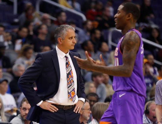 Suns coach Igor Kokoskov looks on as Jamal Crawford during the first half of a game Friday at Talking Stick Resort Arena.
