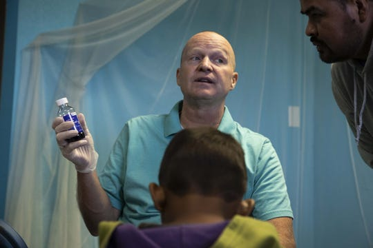 Dr. Dan Bishop and church volunteers give out medicine to migrant children who are sick at Casa de Oracion Number 2.