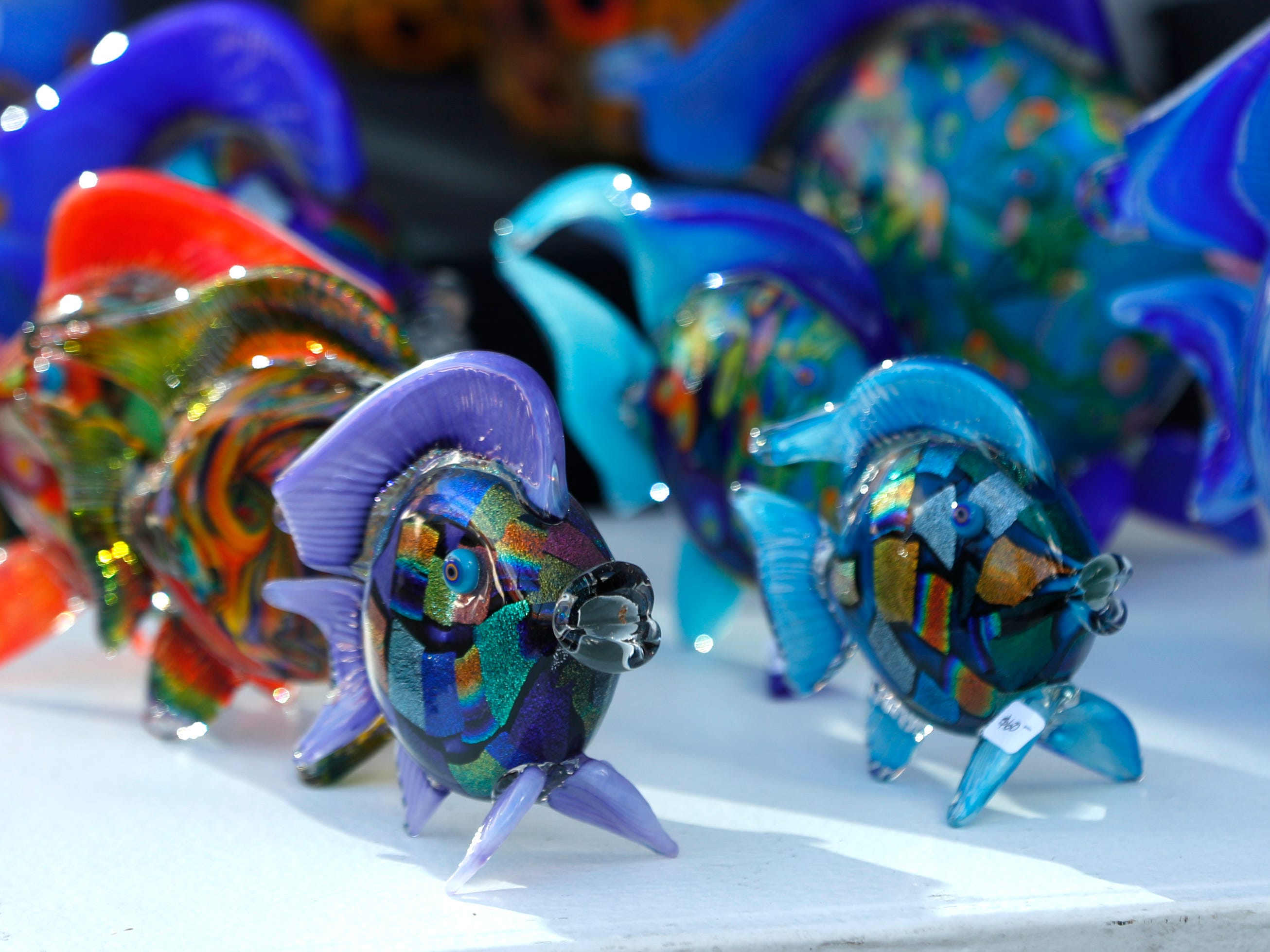 Glass fish for sale at the Tempe Festival of the Arts on Mill Avenue on Friday, November 30, 2018.