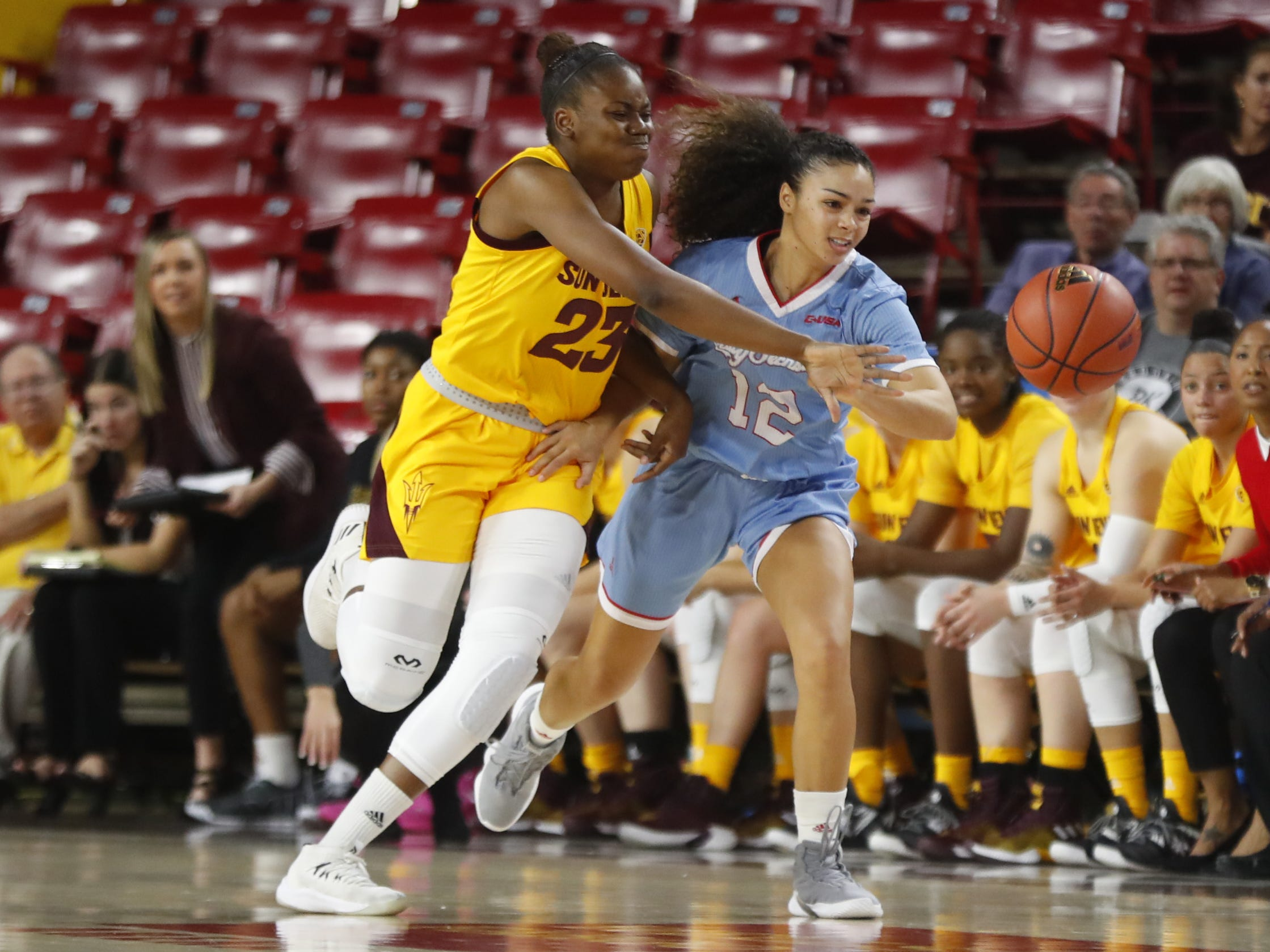 ASU's Iris Mbulito (23) attempts to steal the ball away from Louisiana Tech's Daria McCutcheon (12) during the first half at Wells Fargo Arena in Tempe, Ariz. on November 30, 2018.