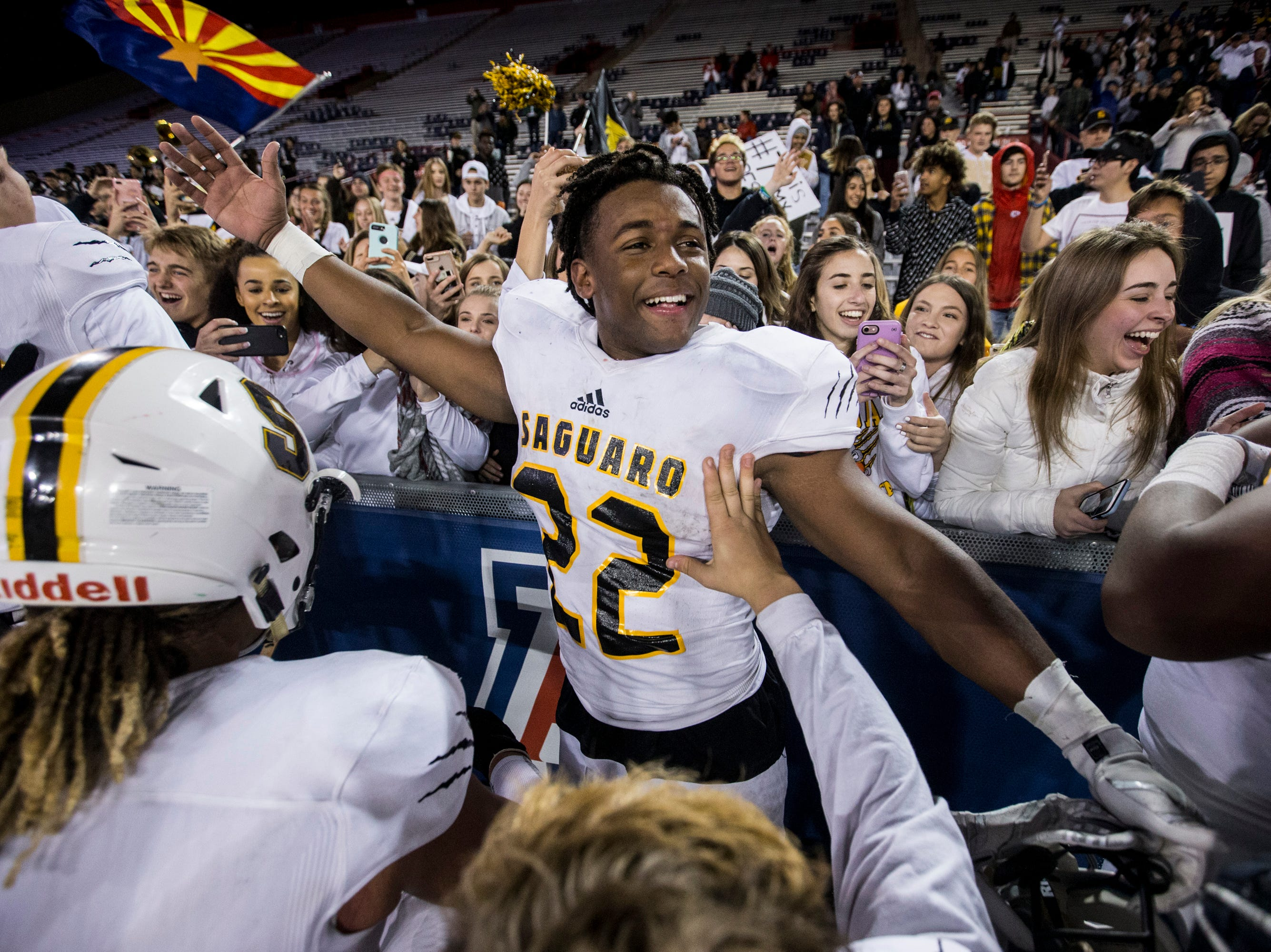 Saguaro's Israel Benjamin celebrates after defeating Salpointe for the 4A State Championship on Friday, Nov. 30, 2018, at Arizona Stadium in Tucson, Ariz. Saguaro won, 42-16.