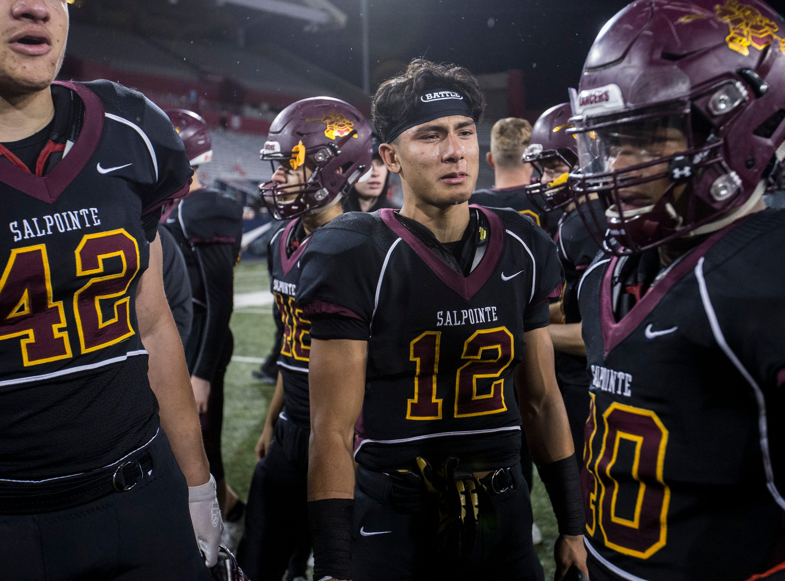 Salpointe players cry after losing to Saguaro for the 4A State Championship on Friday, Nov. 30, 2018, at Arizona Stadium in Tucson, Ariz. Saguaro won, 42-16.
