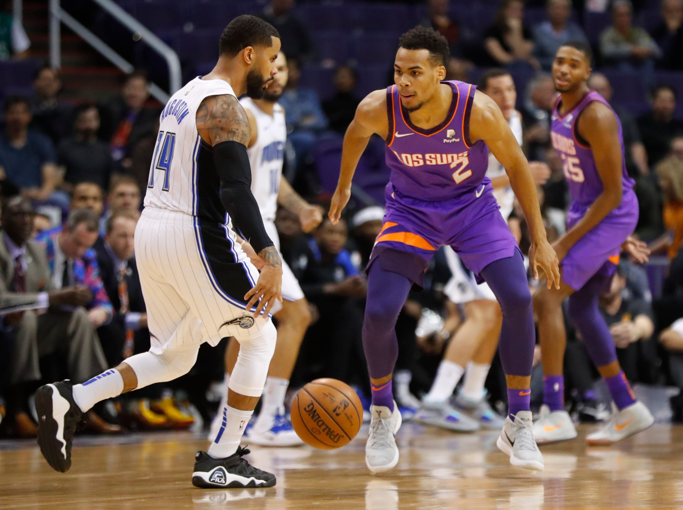 Suns' Elie Okobo (2) defends Magic's DJ Augustin (14) during the first half at Talking Stick Resort Arena in Phoenix, Ariz. on November 30, 2018.