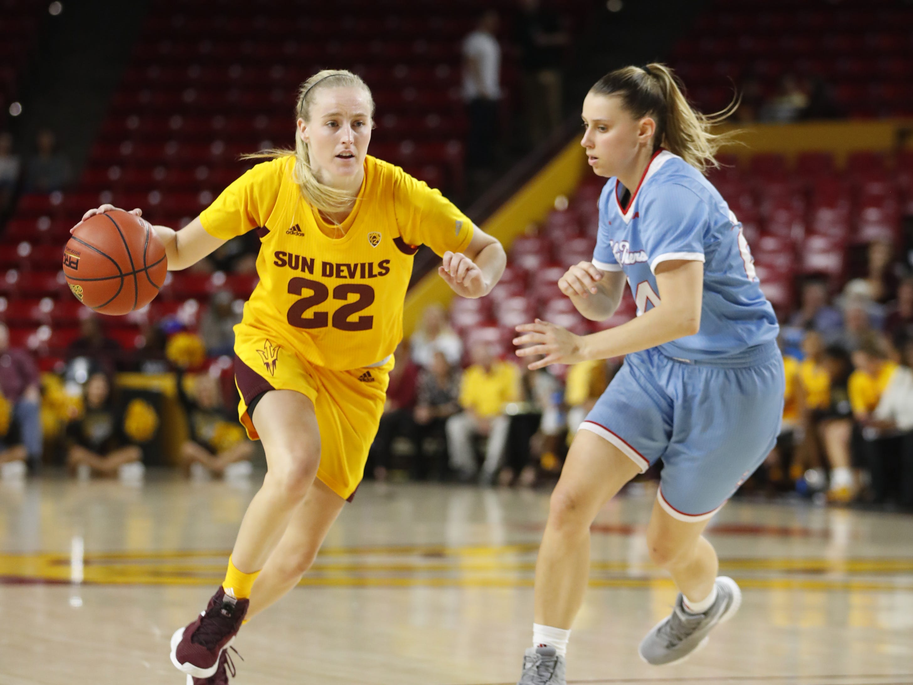 ASU's Courtney Ekmark (22) drives against Louisiana Tech's Taylor Stahly (24) during the first half at Wells Fargo Arena in Tempe, Ariz. on November 30, 2018.