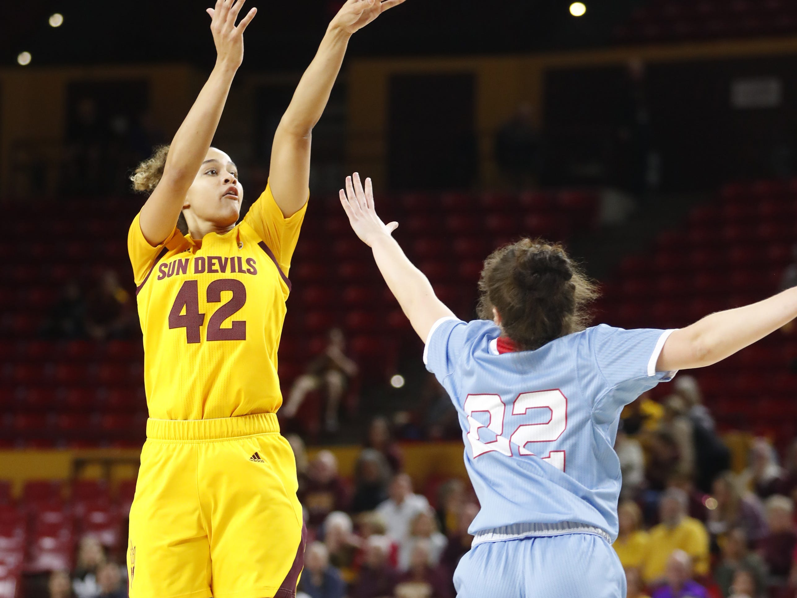 ASU's Kianna Ibis (42) shoots against Louisiana Tech's Grayson Bright (22) during the first half at Wells Fargo Arena in Tempe, Ariz. on November 30, 2018.
