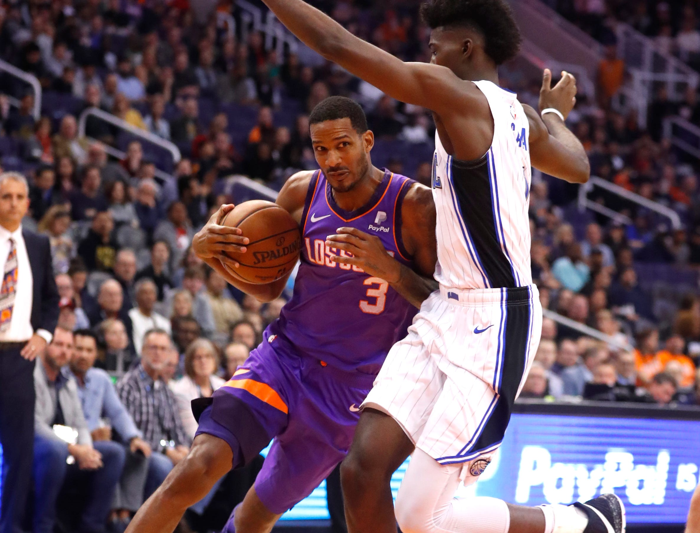 Suns' Trevor Ariza (3) drives the paint against Magic's Jonathan Isaac (1) during the first half at Talking Stick Resort Arena in Phoenix, Ariz. on November 30, 2018.