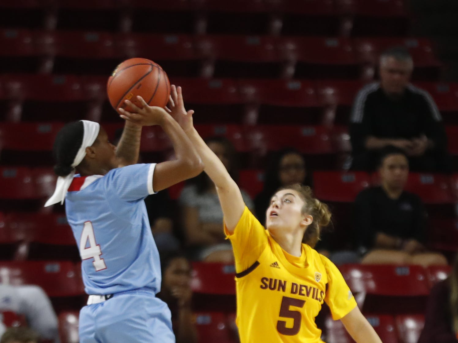 ASU's Jamie Lorea (5) blocks a shot from Louisiana Tech's Kierra Anthony (4) during the first half at Wells Fargo Arena in Tempe, Ariz. on November 30, 2018.