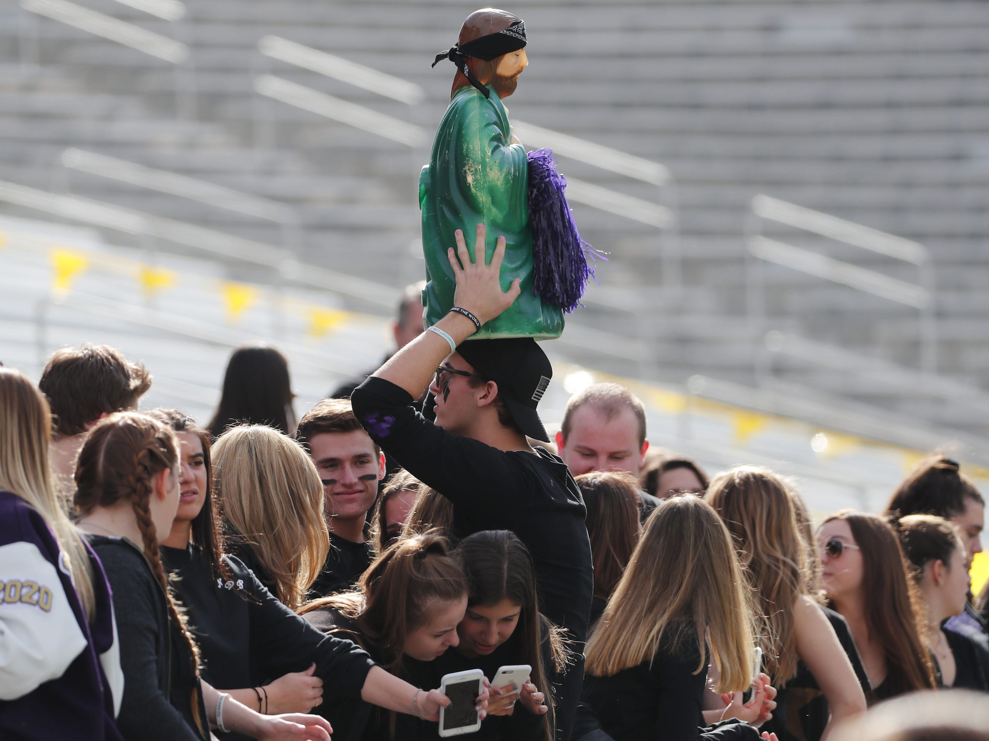 Notre Dame Prep students hold a statue during the 5A state football championship game against Centennial at Sun Devil Stadium December 1, 2018. #azhsfb
