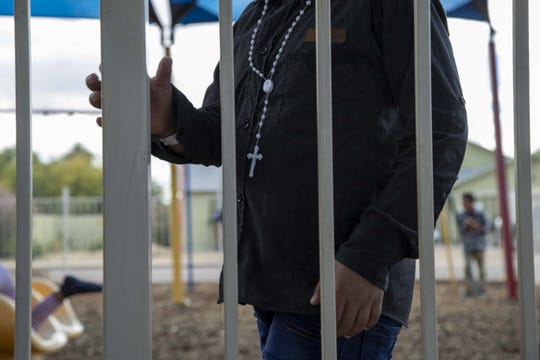 A migrant child at Casa de Oracion Number 2 in north Phoenix.