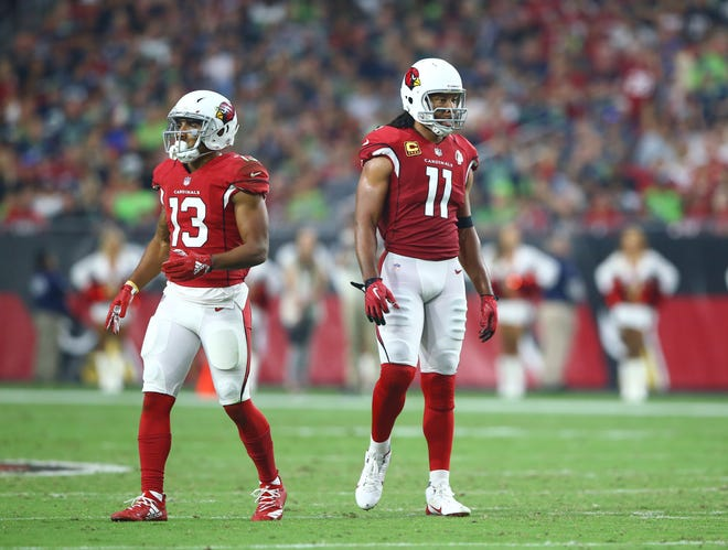 Sep 30, 2018: Arizona Cardinals wide receiver Larry Fitzgerald (11) and Christian Kirk (13) against the Seattle Seahawks at State Farm Stadium.