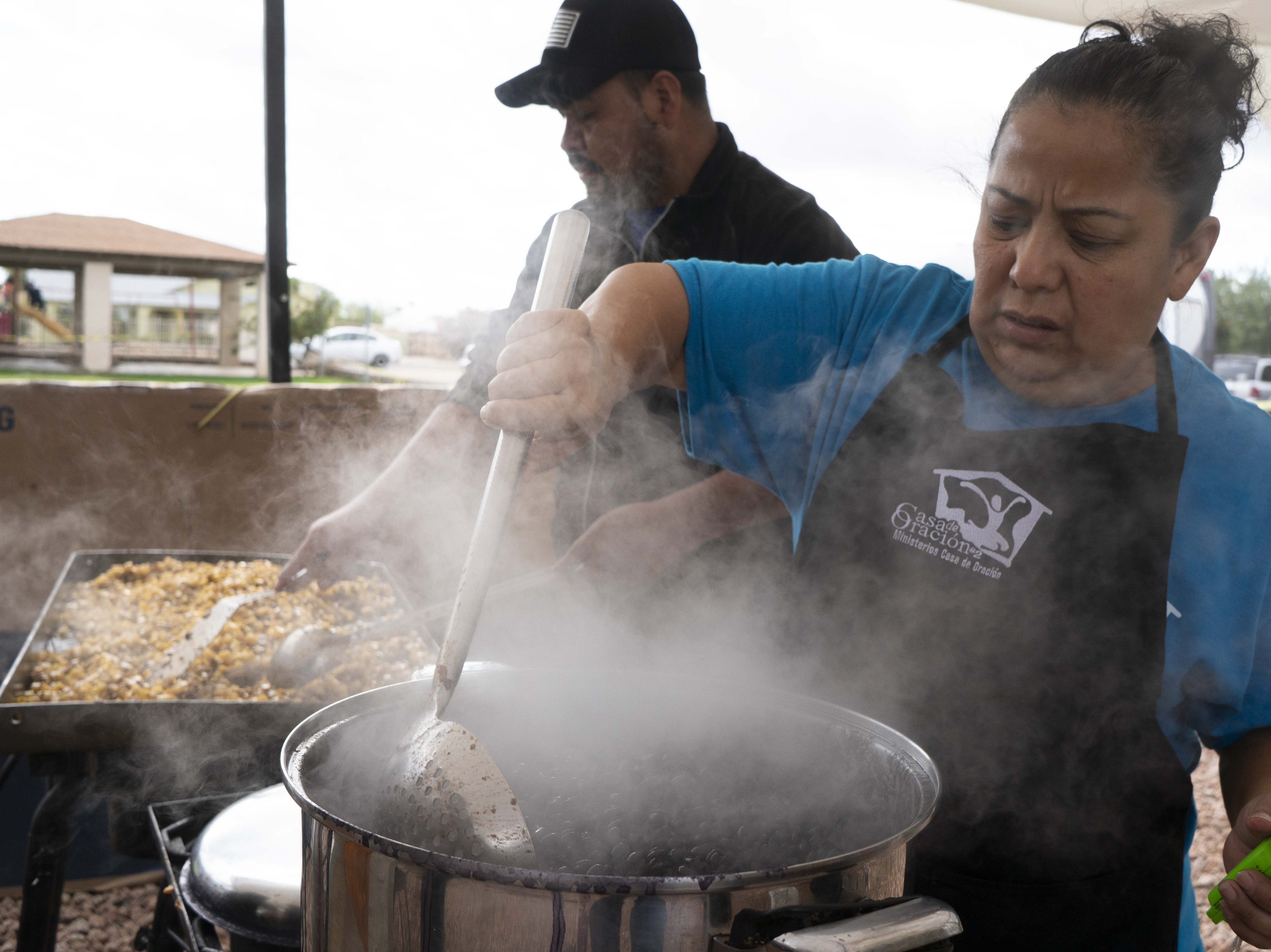 Church members prepare food for migrant families from Central America.